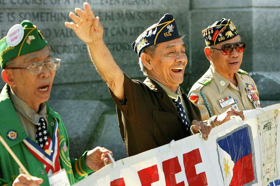 "WASHINGTON - OCTOBER 31:  Filipino-American WWII veterans (L-R) Fred Diaz of Jersey City, New Jersey, Franco Arcebal and Regino Nacua, both of San Francisco, sing ""Old Soldiers Never Die"" during a wreath-laying ceremony at the National WWII Memorial to mark the Filipino holiday ""All Souls 10. Filipino – 2.4 percent of Seattle residents, or about 15,000 people. Photo: Chip Somodevilla, Getty Images / 2007 Getty Images"