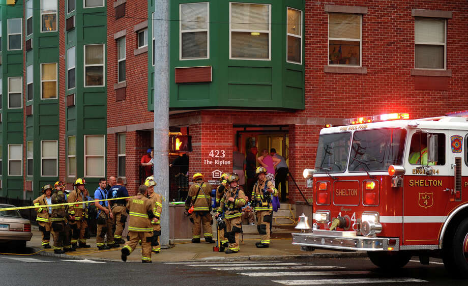 Shelton Firefighters were called to a small kitchen fire at The Ripton apartments at Howe Avenue and Center Street in downtown Shelton, Conn. on Tuesday September 26, 2012. Photo: Christian Abraham / Connecticut Post
