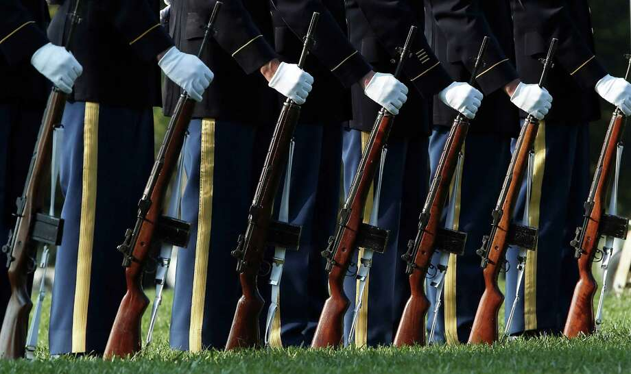 A U.S. Army firing party stands ready during the burial service of U.S. Army Chief Warrant Officer 2 Thalia S. Ramirez at Arlington National Cemetery September 26, 2012 in Arlington, Virginia. Photo: Win McNamee, Getty Images / 2012 Getty Images
