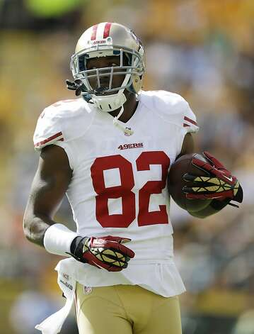 Mario Manningham helped set up a visit to a 49ers practice for players from his high school. Photo: Jeffrey Phelps, Associated Press