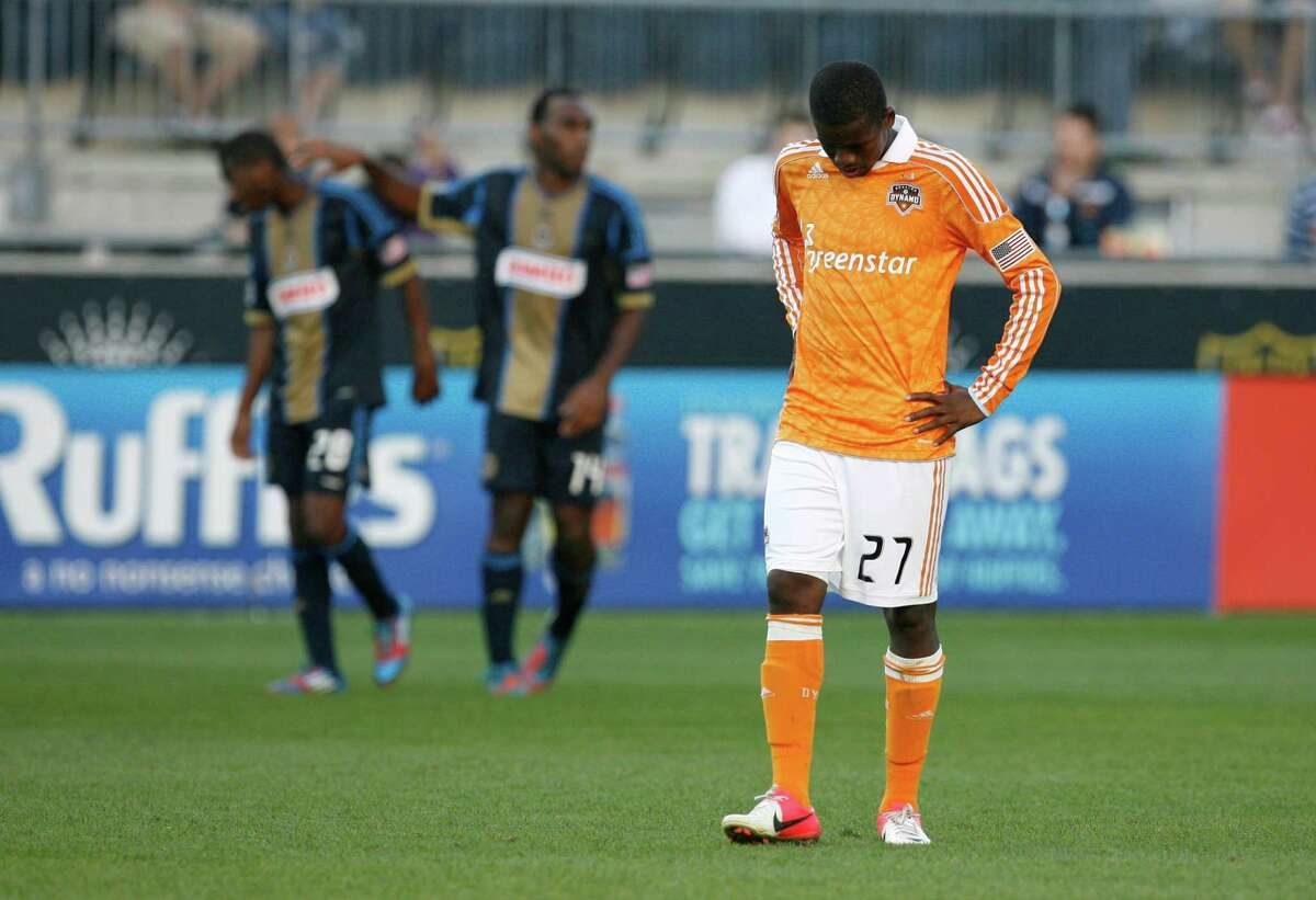 Boniek Garcia, right, sums up how the Dynamo felt about their performance Sunday in Philadelphia, a 3-1 loss to an 8-14-6 team.
