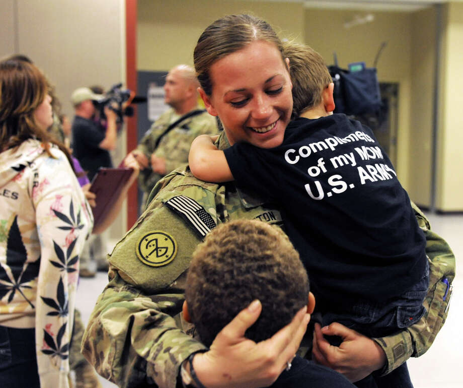Specialist Tiffany Sutton of Richfield Springs hugs her sons Silas Sutton, 8, left, and Aiden Kiley, 2, as she returns home from Afghanistan at the Scotia Armed Forces Readiness Center Wednesday, Sept. 26, 2012 in Glenville, N.Y.  25 Soldiers of the 2nd Battalion-108th Infantry arrived back home at their New York Army National Guard armory. (Lori Van Buren / Times Union) Photo: Lori Van Buren