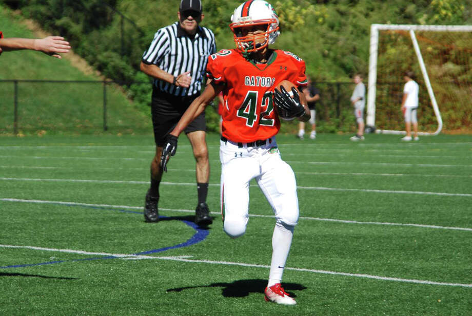 Senior Gators running Back Cassius Johnson carries against the Putnam Generals. Sept. 2012 Photo: Contributed Photo