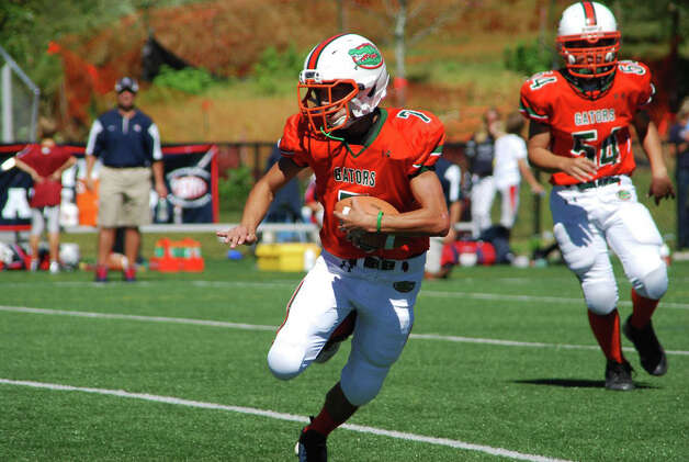 Senior Gators quarterback Anthony Ferraro runs against the Putnam Generals. September 2012. Photo: Contributed Photo