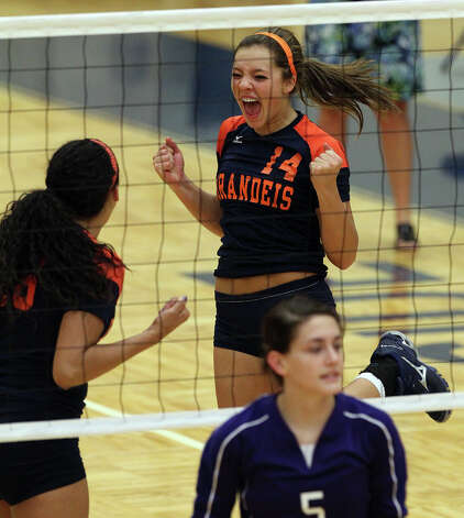 Brandeis' Joanna Neu (14) reacts after scoring against Warren's Lauren McQueen (05) in high school volleyball at Taylor Fieldhouse on Wednesday, Sept. 26, 2012. Photo: Kin Man Hui, San Antonio Express-News / ©2012 San Antonio Express-News