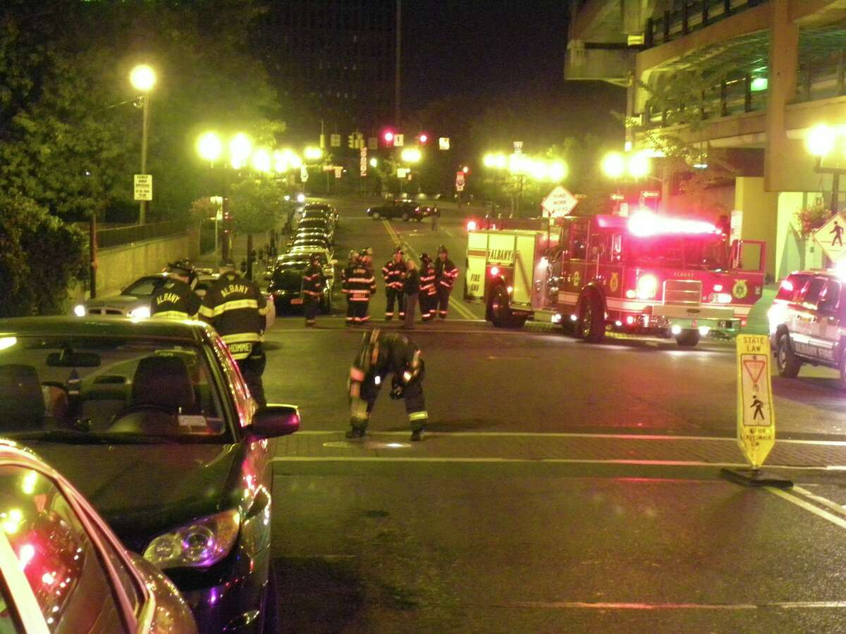 Emergency personnel are at the scene in downtown Albany on Wednesday night after smoke was seen coming from underground and a manhole became dislodged. (Steve Barnes / Times Union)