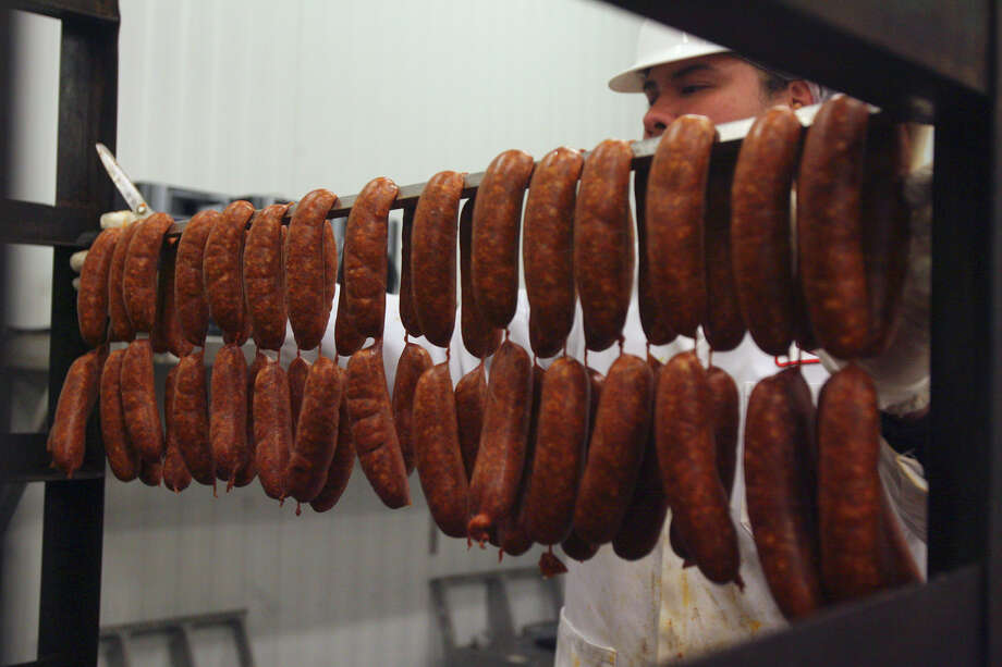 Elvis Gutierrez cuts chorizo links apart on Monday November 16, 2009 at the Kiolbassa Provision Company. The company has been named by the State Historical Commission as a Texas Treasure Business Award recipient. JOHN DAVENPORT/jdavenport@express-News.net Photo: JOHN DAVENPORT, . / jdavenport@express-news.net