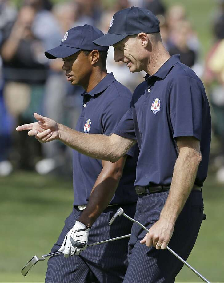Jim Furyk (right) needs to improve his Ryder Cup play, while Tiger Woods stepped up in 2006 and '10. Photo: Chris Carlson, Associated Press