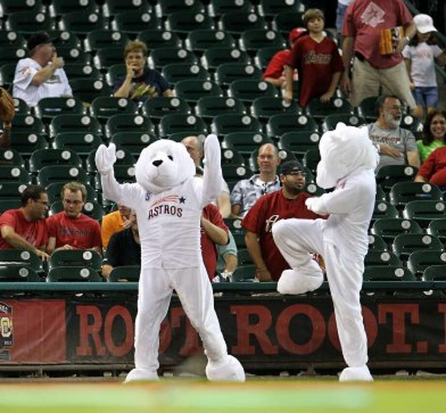 The mascots vying for the new mascot position entertain fans as they were evaluated before the start of the game. ( Karen Warren / Houston Chronicle ) (Karen Warren / Houston Chronicle)