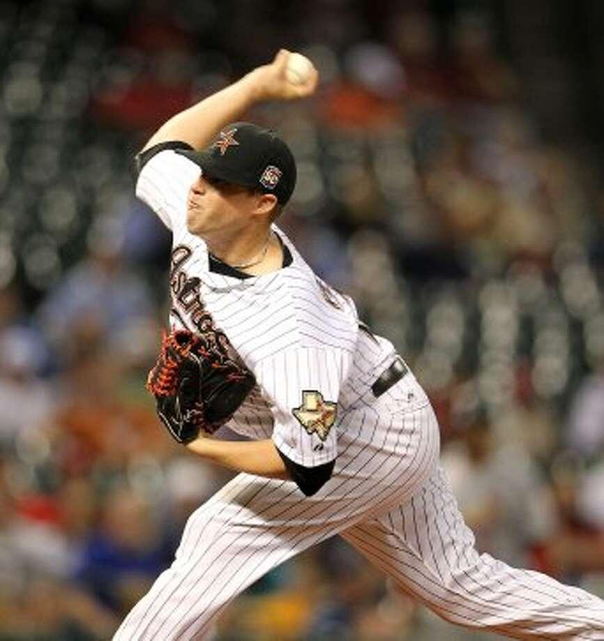 Bud Norris (20) pitches during the first inning. ( Karen Warren / Houston Chronicle ) (Karen Warren / Houston Chronicle)