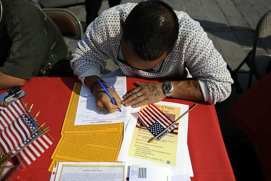 Raymond Nicassio of Fremont fills out his form during a voter-registration drive in downtown Oakland on Tuesday. Photo: Michael Short, Special To The Chronicle