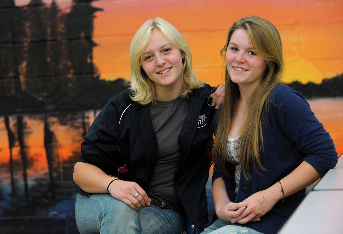 From left, sisters Breanna Flint, 17, and Lindsey Flint, 16 Tuesday, Sept. 25, 2012 in Galway, N.Y. The Galway High School sisters participate in the sport of shooting. (Lori Van Buren / Times Union)