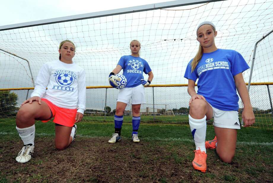 Shaker High school girls' soccer goalie Gabby Cotugno, center, with defenders Lynn Roberts, left, and McKenzie Riccio in Latham, NY Wednesday Sept. 26, 2012. (Michael P. Farrell/Times Union) Photo: Michael P. Farrell