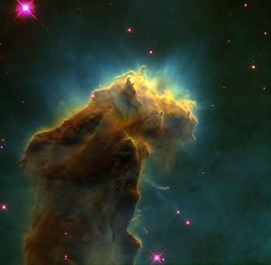 "Yet another view of one of the ""Pillars of Creation"" in the Eagle Nebula."