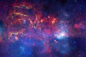 This is the center of our galaxy, a composite photo taken by Hubble in near-infrared light, the Spitzer Space Telescope in infrared light and the Chandra X-ray Observatory.