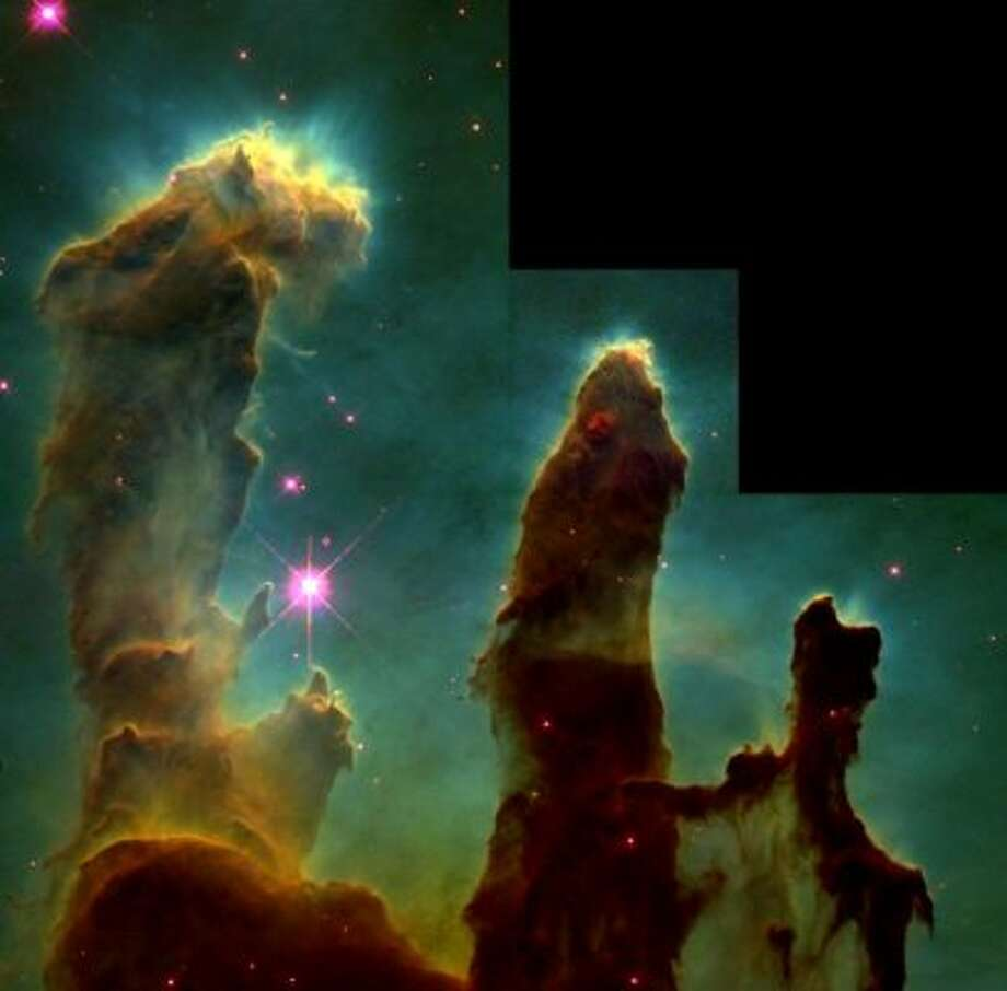 "The ""Pillars of Creation"" in the Eagle Nebula."