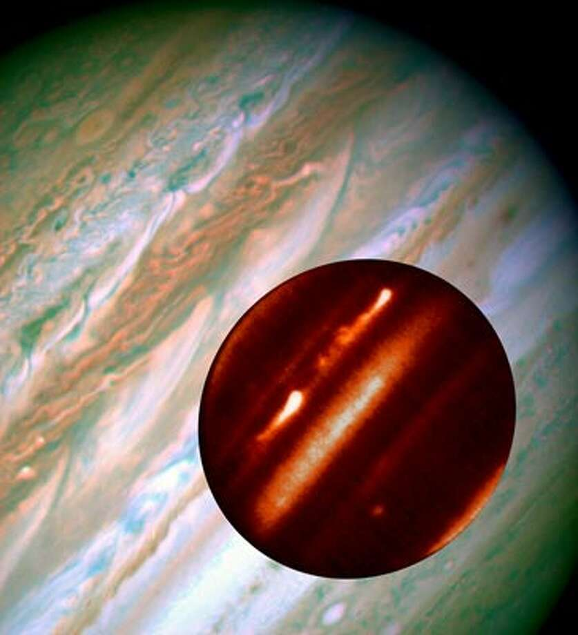 Giant storms occasionally erupt through the swirling gases of Jupiter; here, an infrared image of storm activity is superimposed on a Hubble image taken at roughly the same time.