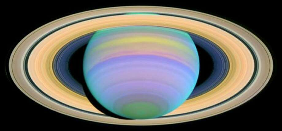 Saturn, with its rings at maximum tilt of 27 degrees, shot in ultraviolet light.