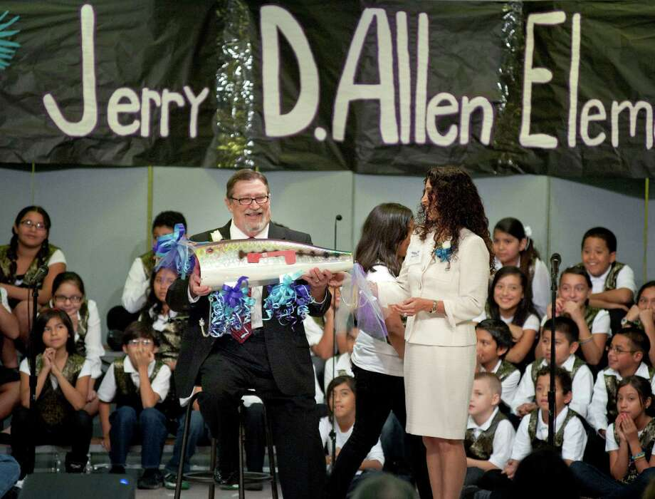 Retired Lackland City Elementary principal Jerry Allen gets a standing ovation during the school's renaming ceremony. Photo: Darren Abate, For The Express-News