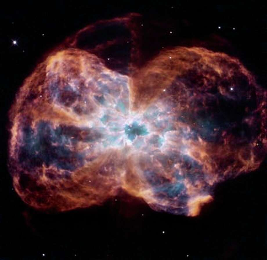 Planetary nebula NGC 2440 with a white dwarf at its center.
