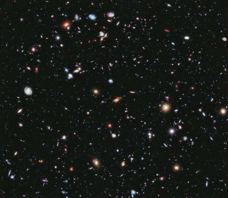 Called the eXtreme Deep Field, or XDF, the photo was assembled by combining 10 years of NASA Hubble Space Telescope photographs taken of a patch of sky at the center of the original Hubble Ultra Deep Field. (Credit: NASA; ESA; G. Illingworth, D. Magee, and P. Oesch, University of California, Santa Cruz; R. Bouwens, Leiden University; and the HUDF09 Team)