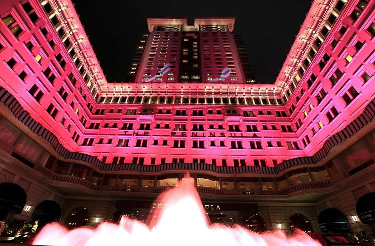 The Peninsula Hong Kong illuminates its exterior in pink in October for Breast Cancer Awareness Month, among other programs at the chain's hotels worldwide designed to raise consciousness or funds for medical research.