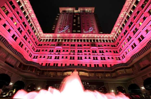The Peninsula Hong Kong illuminates its exterior in pink in October for Breast Cancer Awareness Month, among other programs at the chain's hotels worldwide designed to raise consciousness or funds for medical research. Photo: Peninsula Hotels
