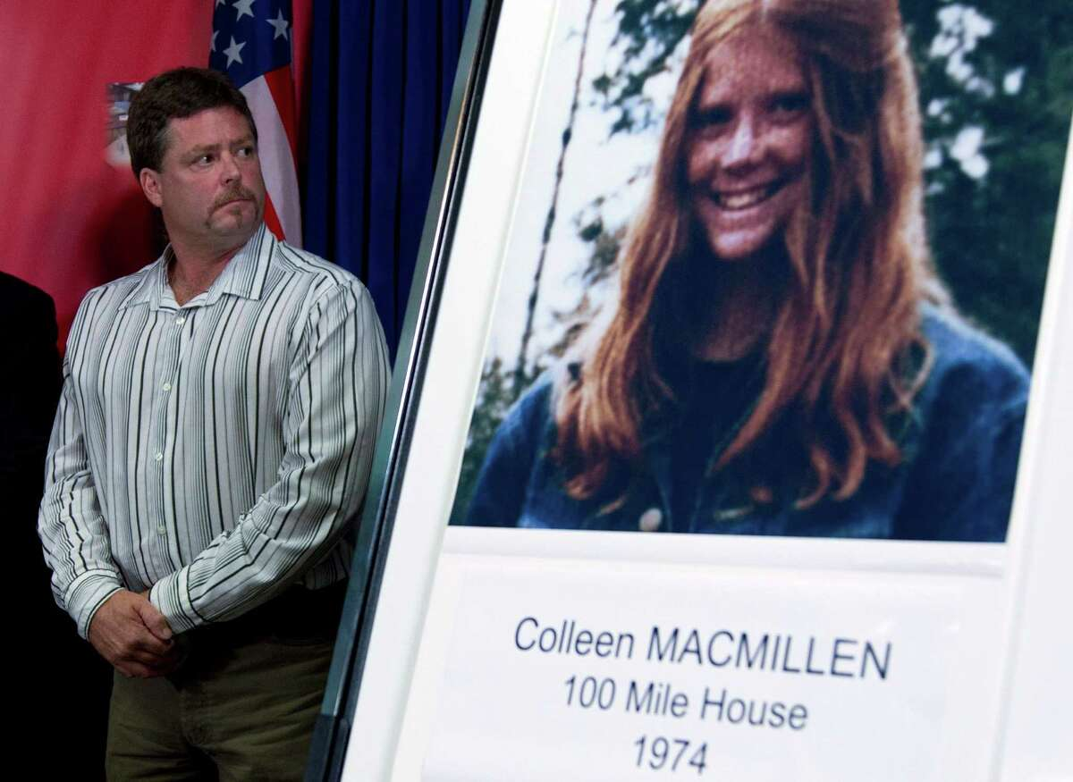 Shawn MacMillen, brother of murder victim Colleen MacMillen, is shown with a poster of his sister during a news conference in Surrey, British Columbia.