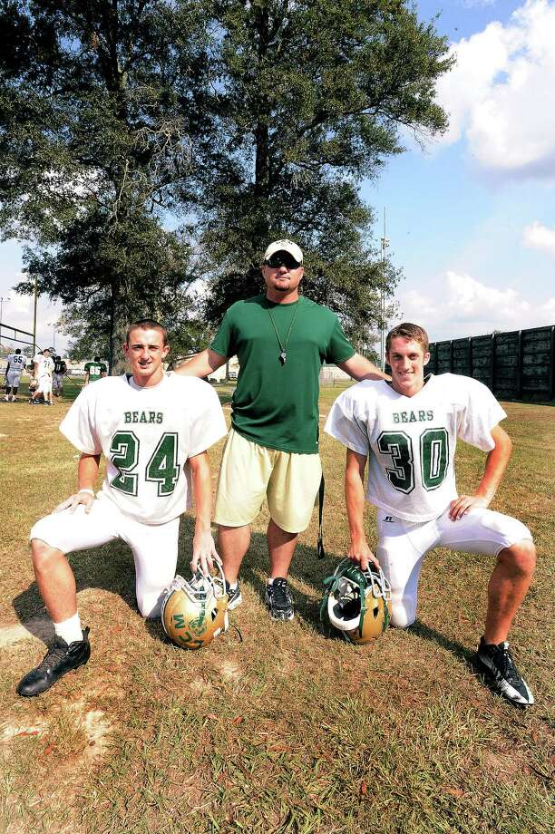 Defensive line coach Levi Moore, center, has served in the military while  Justin Ezell, left, and Caleb Bickham, right, both  plan on joining the military after graduation. Photo taken: Randy Edwards/The Enterprise Photo: Randy Edwards