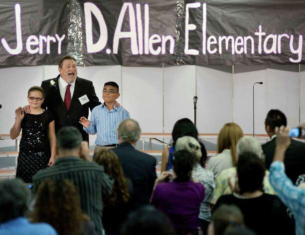 During a ceremony to mark the renaming of Lackland City Elementary to Jerry D. Allen Elementary, retired Lackland City Elementary principal Jerry D. Allen is escorted by students onto the stage, to a standing ovation from attendees, Wednesday, Sept. 26, 2012, at Jerry D. Allen Elementary School in San Antonio. Photo: Darren Abate, Darren Abate/For The Express-New