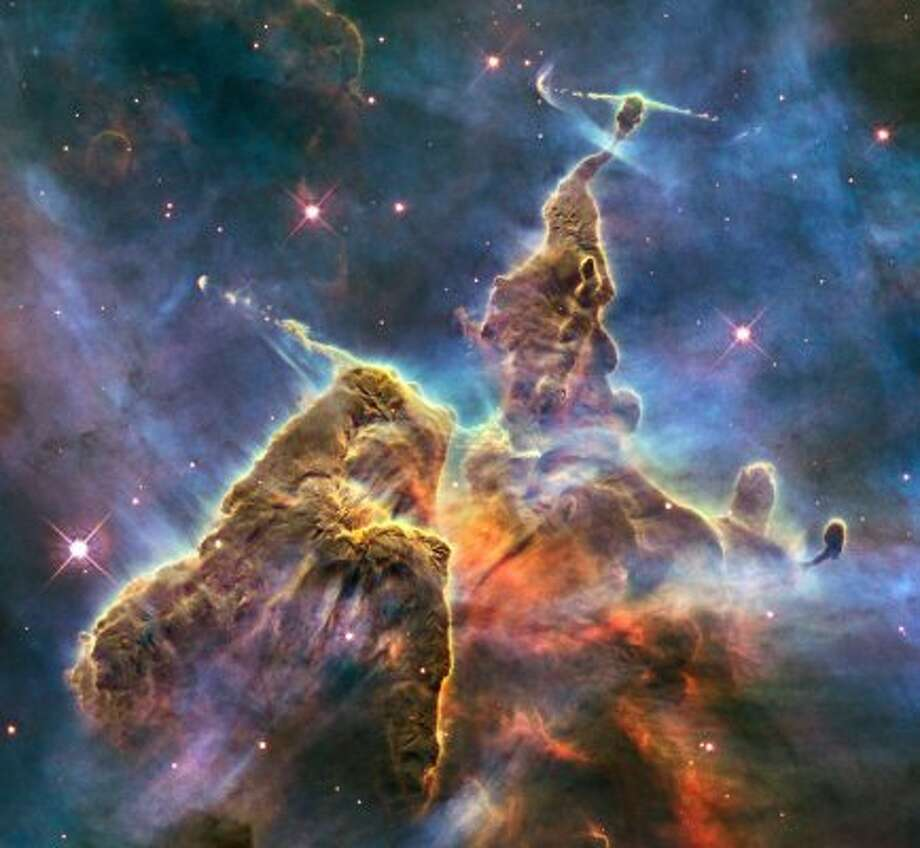 "The Hubble has produced some of our most fantastic photos from space, such as this one which shows the ""Pillar and Jets"" section of the Carina Nebula.