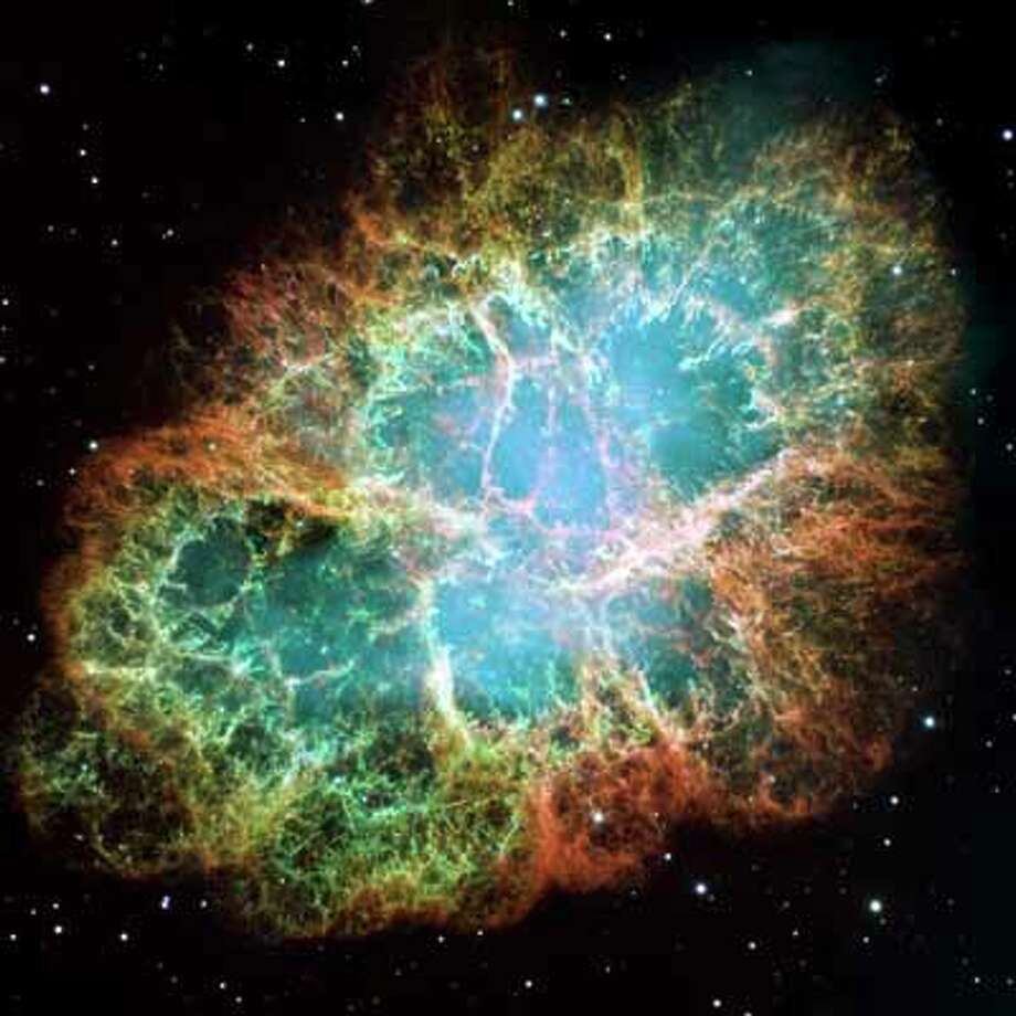 The Crab Nebula as shot by Hubble alone. It's about 6,500 light years away in the constellation Taurus.