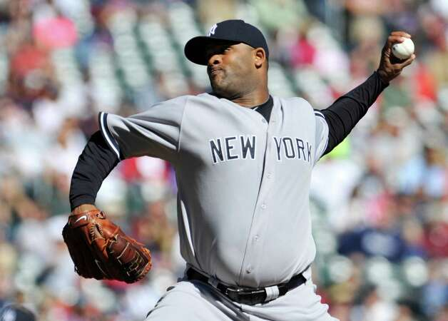 New York Yankees pitcher CC Sabathia throws against the Minnesota Twins during the first inning of a baseball game, Wednesday, Sept. 26, 2012 in Minneapolis. (AP Photo/Jim Mone) Photo: Jim Mone