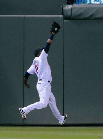 Minnesota Twins center fielder Denard Span catches a fly ball by New York Yankees' Alex Rodriguez during the sixth inning of a baseball game Tuesday, Sept. 25, 2012, in Minneapolis. (AP Photo/Jim Mone) Photo: Jim Mone