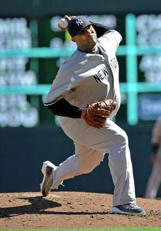 New York Yankees pitcher CC Sabathia throws against the Minnesota Twins during the second inning of a baseball game, Wednesday, Sept. 26, 2012 in Minneapolis. (AP Photo/Jim Mone) Photo: Jim Mone