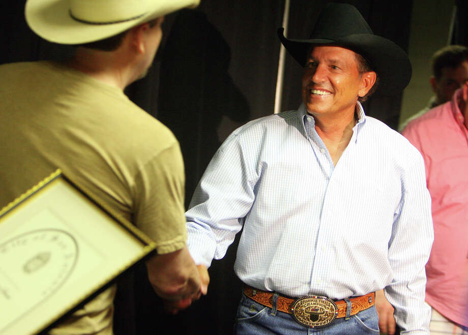 George Strait meets KJ97 dj Randy Carroll before being presented with a City if San Antonio Emissary of the Muses Award by Mayor Julian Castro before his concert at the Alamodome, Saturday, May 1, 2010.  Photo: JENNIFER WHITNEY, SPECIAL TO THE EXPRESS-NEWS / SAN ANTONIO EXPRESS-NEWS