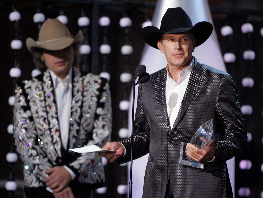 "George Strait accepts the album of the year award for his work on ""It Just Comes Natural,"" as presenter Dwight Yoakam looks on at the 41st Annual Country Music Association Awards, Wednesday, Nov. 7, 2007, in Nashville, Tenn. Photo: Mark Humphrey, AP / AP"
