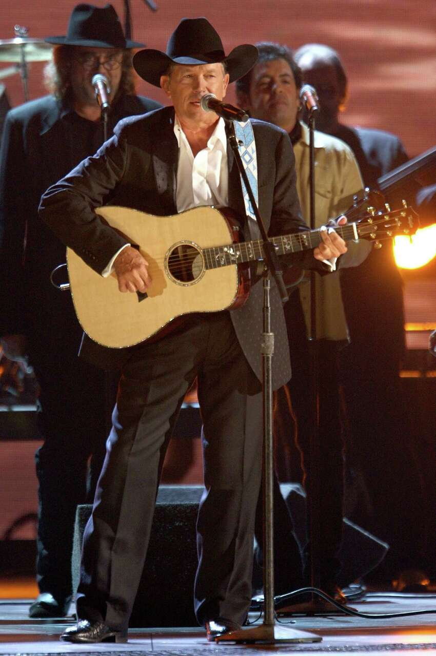 George Strait sure cleans up well. Here he is performing for thousands at the 42nd Annual CMA Awards in 2008.