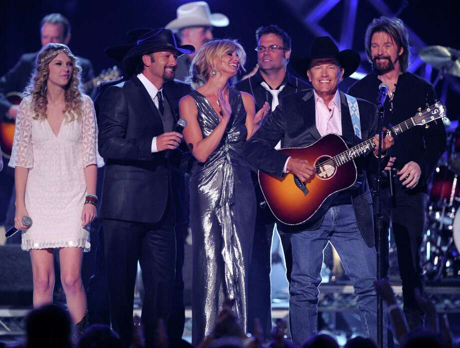 George Strait, second right, is joined by other country artist at the finale of the ACM Artist of the Decade All Star Concert in his honor on Monday, April 6, 2009, in Las Vegas. From left are, Taylor Swift, Tim McGraw, Faith Hill,Troy Gentry,George Strait, and Ronnie Dunn. Photo: Mark J. Terrill, AP / AP