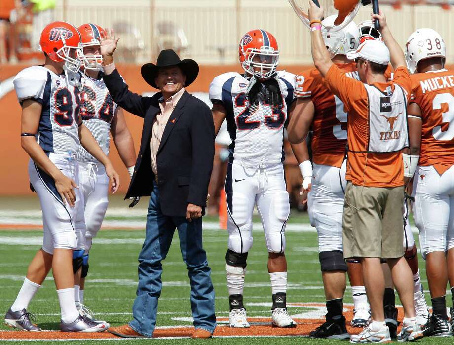 Country-western star George Strait waves to the crowd prior to the start of the game between the University of Texas Longhorns against the University of Texas El Paso Miners at Darrell K. Royal Stadium in Austin on Saturday, Sept. 26, 2009. Photo: Kin Man Hui, San Antonio Express-News / kmhui@express-news.net