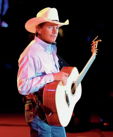 George Strait will perform in San Antonio on June 1. Photo: Associated Press / FRONT PAGE PUBLICITY