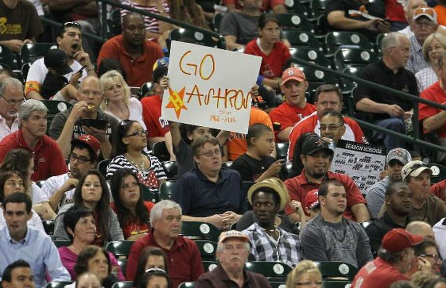 "Sept. 26: Astros 2, Cardinals 0Astros fans flash a ""Go Astros&quot"
