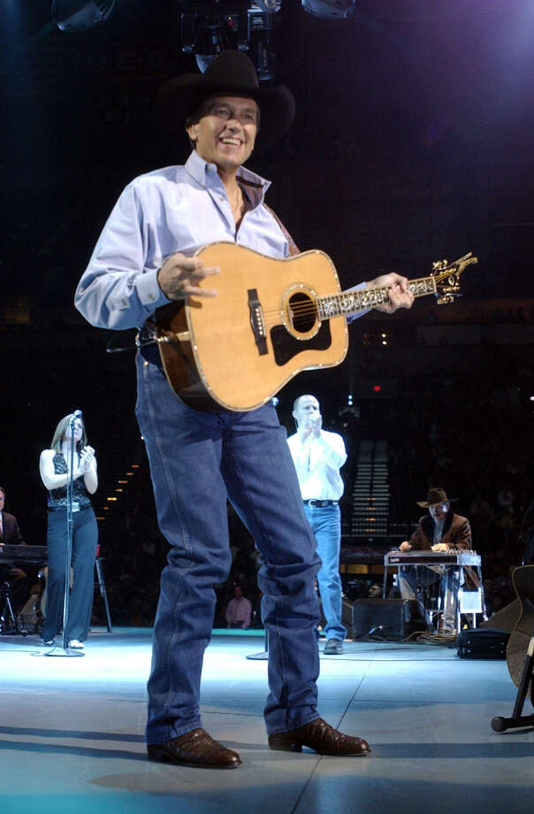 George Strait performs Saturday night November 2, 2002 at the SBC Center. Strait's performance was the first concert held in the newly opened facility.  Photo: WILLIAM LUTHER, SAN ANTONIO EXPRESS-NEWS / SAN ANTONIO EXPRESS-NEWS