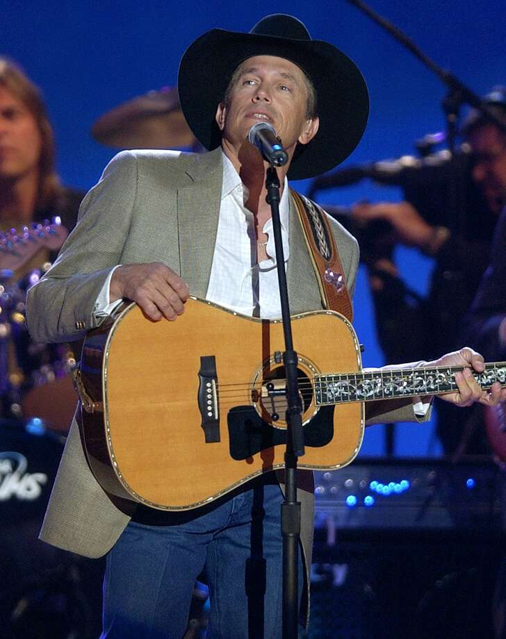 George Strait performs a medley of his songs at the 38th annual Academy of Country Music Awards, Wednesday, May 21, 2003, in Las Vegas. Strait was later presented with the organization's Special Achievement Award. Photo: JOE CAVARETTA, AP / AP
