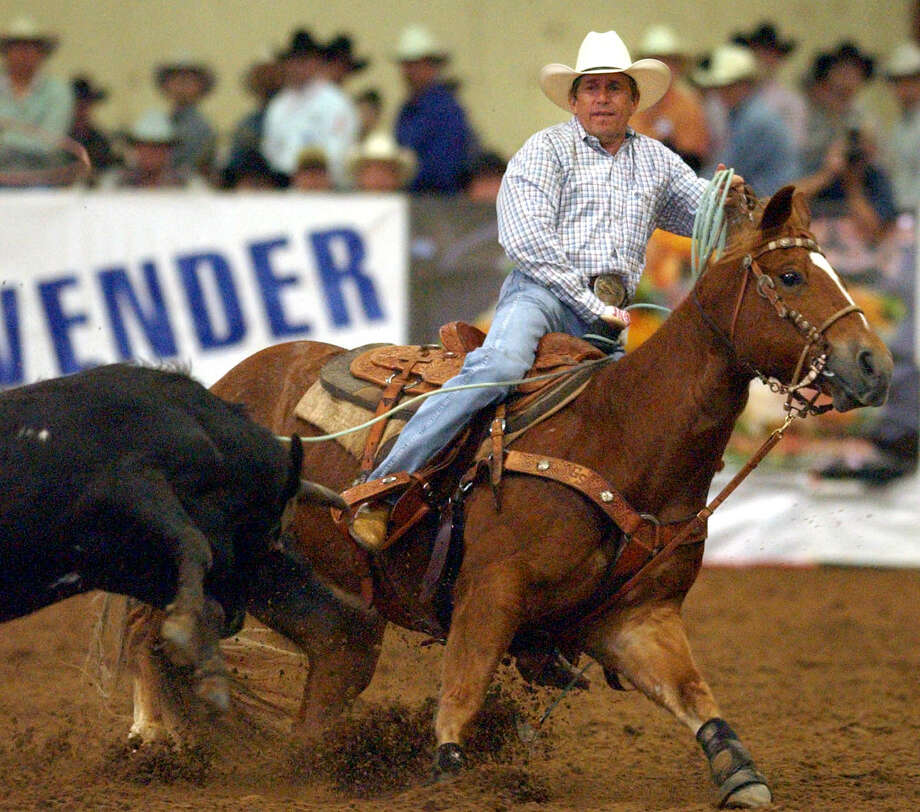 Country singer George Strait pulls back after roping a steer during the George Strait Team Roping Classic held at the Rose Palace in Leon Springs, Friday, Mar. 19, 2004. Photo: Bob Owen, SAN ANTONIO EXPRESS-NEWS / SAN ANTONIO EXPRESS-NEWS