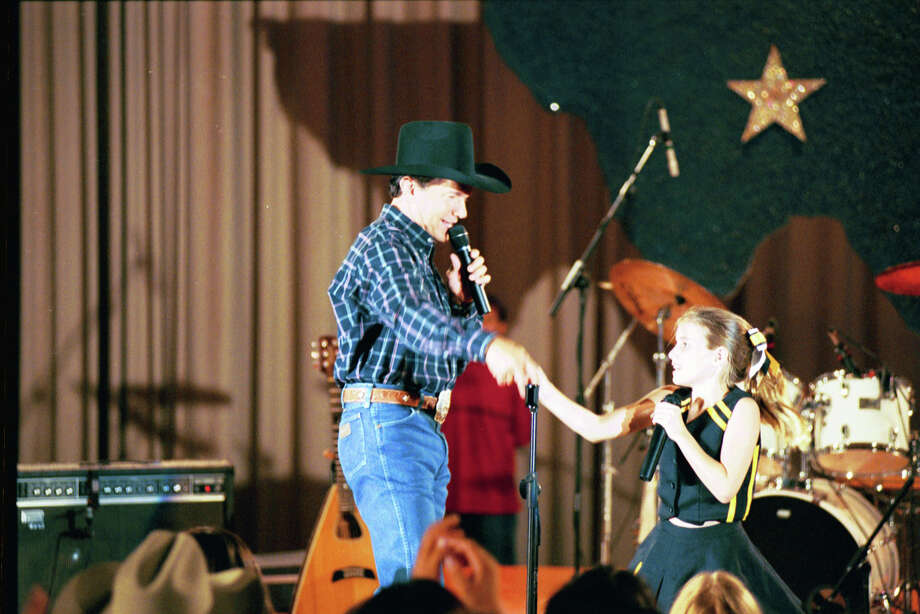 George Strait and Emma Roberts appear in a scene from 'Grand Champion.' 2002 Photo: MADRUGADA RANCH PRODUCTIONS
