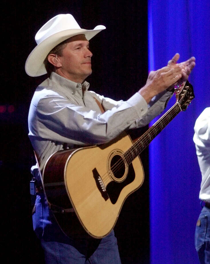 Country music star George Strait performs during the Country Freedom Concert in Nashville, Tenn., Sunday, Oct. 21, 2001. Country music's top stars came together Sunday at the Gaylord Entertainment Center for a concert to benefit victims of the recent terrorist attacks. Photo: MARK HUMPHREY, AP / AP