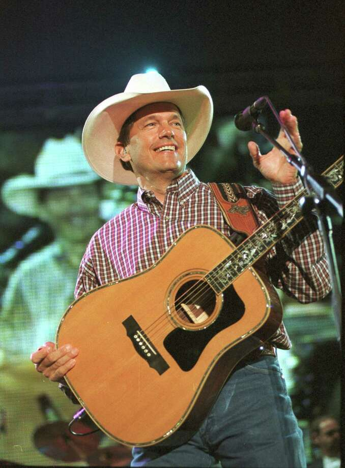 "George Strait performs in this April 7, 2001, file photo in New Orleans. Strait released his new album ""Somewhere Down In Texas"" on MCA Nashville. Photo: CHERYL GERBER, AP / AP"
