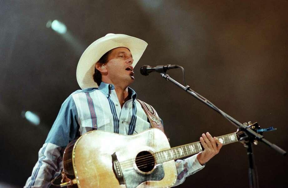 George Strait performs at the Alamodome in 1996. Photo: JERRY LARA, SAN ANTONIO EXPRESS-NEWS / SAN ANTONIO EXPRESS-NEWS