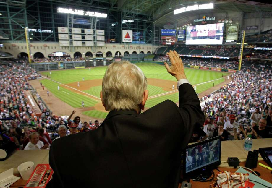 Milo Hamilton waves and addresses the crowd from the radio booth in the 7th inning as he calls the Houston Astros and St. Louis Cardinals game for his last home game as the radio voice of the Astros at Minute Maid Park Wednesday, Sept. 26, 2012, in Houston. Photo: Melissa Phillip, Houston Chronicle / © 2012 Houston Chronicle